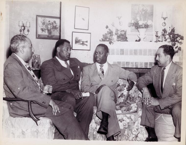 seated l to r: Arna Bontemps, Paul Robeson, Canada Lee & Langston Hughes, 1946